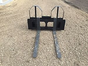 Pallet forks and skid steer attachments