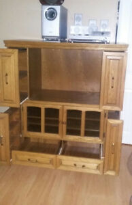 solid oak cabinet with surround sound system
