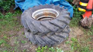 Two sets tractor tires one turf other regular