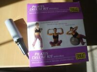 PILATES DELUXE FULL KIT. NEVER USED and BOXED. NEVER USED. BALL; PUMP; HAND WEIGHTS; DVD's etc.
