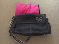 Pink lining brown leather changing bag