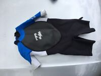 Kids wetsuits. 1x shortie and 1x full length plus 1x pair of wetsuit shoes.