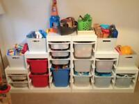 Two ikea toy storage units with toys