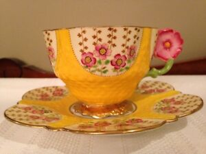 Aynsley- yellow tea cup with pink flower handle