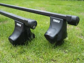Thule Car Roof bars - Model Kit 1036. Used pair complete with integral Thule foot packs and locks.