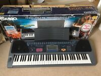 Almost new Casio WX-1200 Keyboard with stand