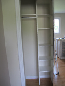 White closet shelves and rod