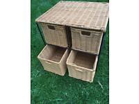 Four wicker drawer set.