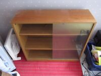 COMPACT TEAK BOOKCASE IN GOOD CONDITION WITH SLIDING GLASS DOORS