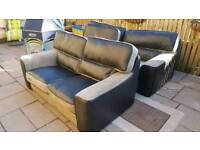 Large matching two and three seater sofas/settees in beige and brown, half leather