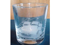 Small New Clear Glass Round Votive Tea Light Candle Holder with a Frosted Ship Image.