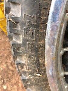 Two tires and rim for sale.
