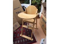 Almost New High Chair, folding with food tray and safety harness