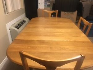 Antique oak dining table and four chairs