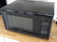 Kenwood Microwave oven - 900 Watt for sale. Colour is black