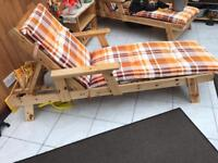 2 SOLID PINE SUNLOUNGERS WITH NEW CUSHIONS