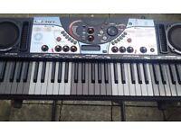 Yamaha DJX II keyboard with pro stand