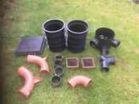 Assorted underground drainage fittings - 4 inch manhole with extensions and lid, bends and grates