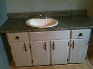 Bathroom vanity with sink and faucets