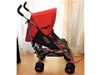 MAMAS AND PAPAS SWIRL PRAM , IN RED RECLINES AND HAS FRONT SWIVEL WHEELS +RAINCOVER