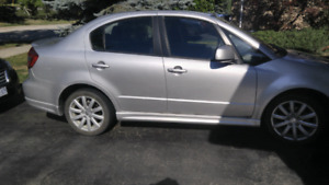 2011 Suzuki sx4 sedan- certified (dented driver fender)