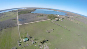 399 Acres of waterfront land + Home & Out Buildings