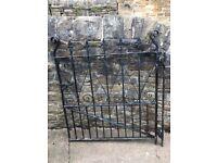 Heavy ornate Victrola style wrought iron gate