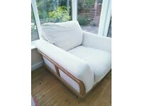 Single white fabric arm chair, solid oak sides