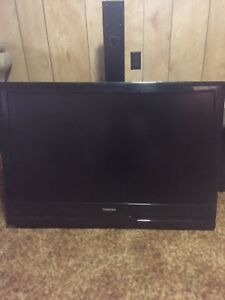 "42"" Toshiba TV with wall mount and stand"
