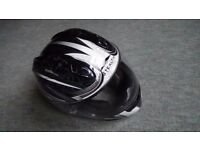 Silver XS full face Stealth helmet ready for a bike ride with you