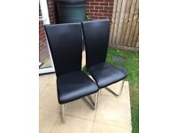 4 Black faux dining room chairs