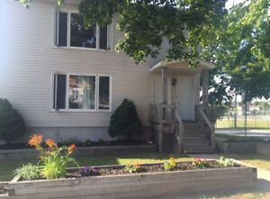 SPACIOUS 4 BEDROOM 2 BATH 2 LEVEL FLAT. UTILITIES INCLUDED SEPT