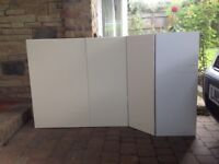 Three IKEA Kitchen wall cupboards, one is a corner unit. Good solid cupboards.