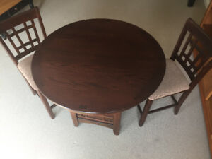 High top dining set with insert leaf and two chairs