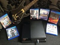 PlayStation 4 Bundle with 6 Games & Guitar