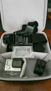 GoPro hero 4 w/ extra batteries and accessories