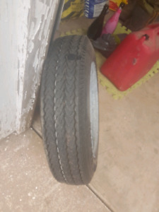 Tent trailer rim and tire