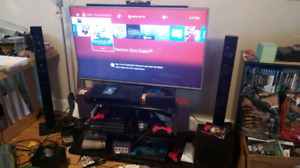 Entertainment Bundle: 4K LG TV with stand and 5.1 surround