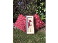 Two Red Cushions and Decoupage Flower Picture