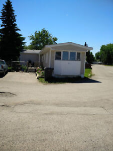 1975 Crestwood Mobile Home Trailer located in Coalhurst.