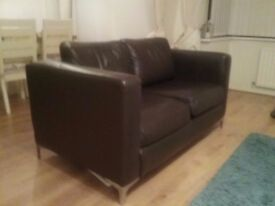 Two seater brown leather sofa,very good condition