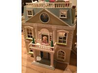Sylvanian Family Hotel complete with tons of furniture, characters and lots of accessories
