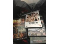 Over 100 DVDs for sale.