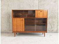 1960's mid century Nathan teak book case / sideboard with sliding glass doors