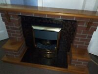 brick design fire surround with coal effect electric fire