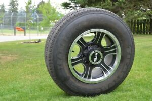 """Assassin 17"""" alloy rims with 97% Firestone 10 ply tires."""