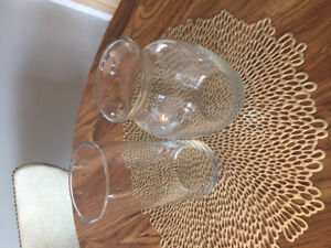 Two modern clear glass vases approx 8-10in tall