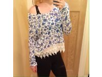Ladies flowers and lace top.