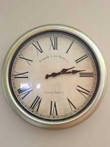 Antique style wall clock with distressed gold finish