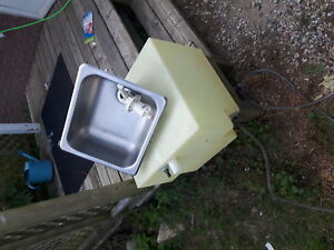 Sink and holding tank for camper